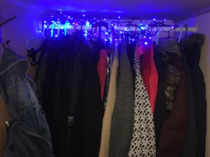 The under-stairs coat cupboard, which has out denim jackets on the left and coats oranised by possession and also thickness (seasonal)